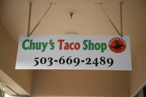 A small, yet colorful sign proudly hangs in front of Chuy's Taco Shop. It gives customers an idea of how colorful the restaurant is.