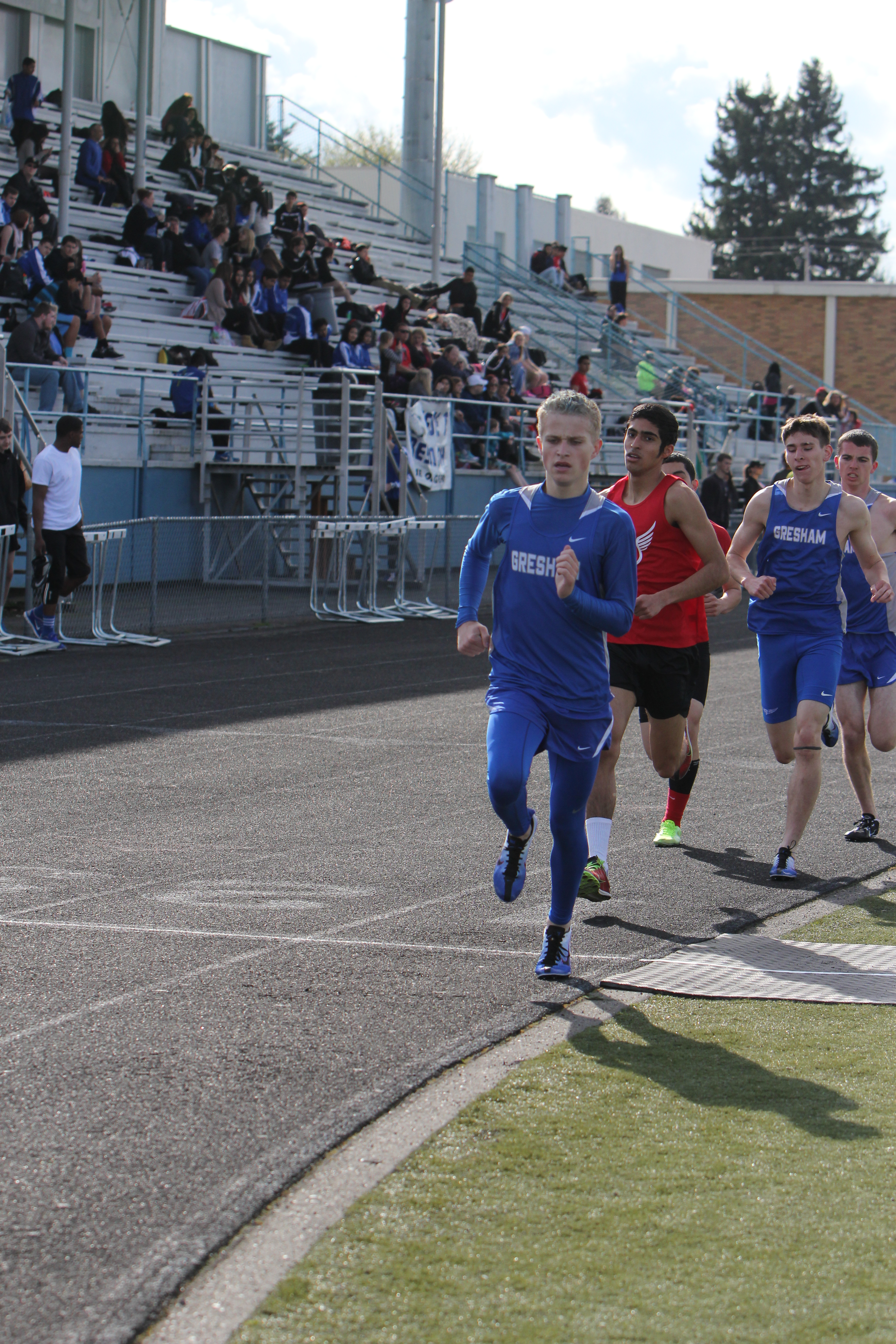 Photo by Teilah Heston Junior Troy Ryals lead the men's varsity 1500m for a short while, followed by seniors Gage Schreiner and Tucker George. George ended the race in first with a time of 4:27.