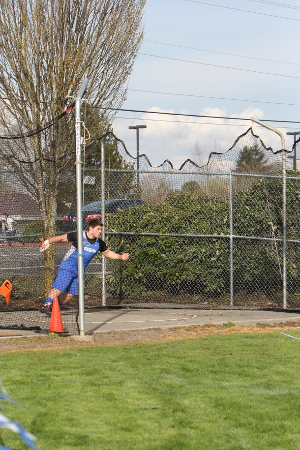 Photo by Teilah Heston Senior Brain Salgado won the men's varsity discus with a throw of 139 feet and 3 inches. Discus was one of two varsity events that saw an all-Gopher sweep.