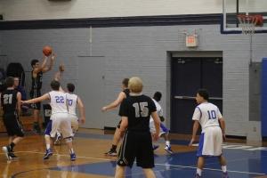 Gresham high man to man defense. Clackamas sophomore, Mitchell Modjeski shoots a three pointer.