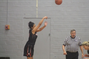 Oregon City junior, Cierra Jones shoots a three pointer.