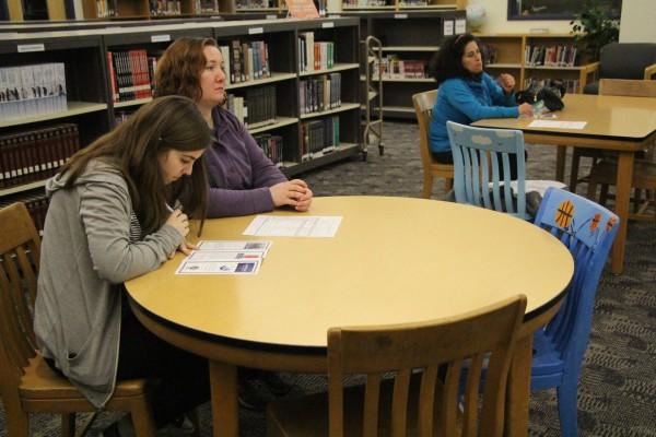 Student looking at IB Brochure.
