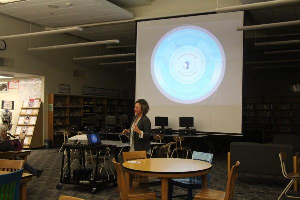 Childress explaining the IB Diploma Program to parents.