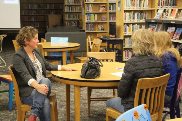Childress and students family talking about grades and difficulties of IB Classes.